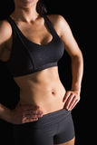 Mid section of slender fit woman posing in sportswear Stock Photos