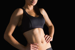 Mid section of slender sporty woman posing in sportswear Stock Image