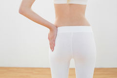Mid section on slender woman posing in sportswear with hand on hip Royalty Free Stock Photography