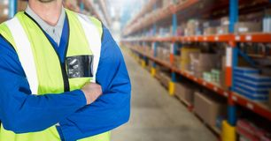 Mid section of supervisor standing with arms crossed. In warehouse Royalty Free Stock Photos