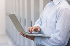 Mid section of a technician typing on his notebook Royalty Free Stock Photo