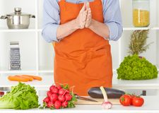 Close up of unrecognizable man preparing to chopfresh nutrion with kitchen knife on cutting board. Mid section of unrecognizable man preparing to chopfresh Royalty Free Stock Photo