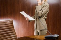 Mid section view of a businesswoman talking on the telephone Royalty Free Stock Image