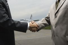 Mid section view of two businessmen shaking hands Stock Image