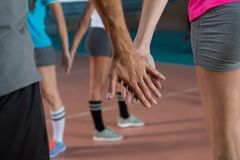 Mid section of volleyball players holding hands Royalty Free Stock Photography