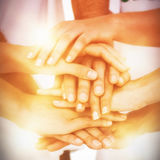 Mid section of volunteers putting hands together royalty free stock photography