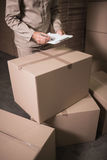 Mid section of warehouse worker with clipboard Stock Photography