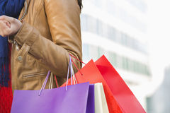 Mid section of woman carrying shopping bags Stock Images