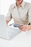 Mid section of a woman doing online shopping Stock Image