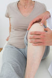 Mid section of a woman getting her knee examined Stock Images