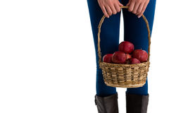 Mid section of woman holding apples in wicker basket stock images