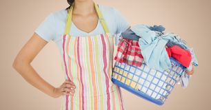 Mid section of woman holding basket full of clothes Royalty Free Stock Photography