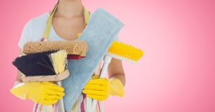 Mid section of woman holding cleaning equipment Stock Photography
