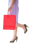 Mid section of woman holding red shopping bag Royalty Free Stock Photo