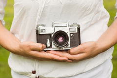 Mid section of woman holding retro camera Stock Image