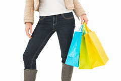 Mid section of woman holding shopping bags Royalty Free Stock Photography