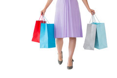 Mid section of woman holding shopping bags Stock Images