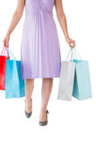 Mid section of woman holding shopping bags Stock Photos