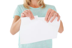 Mid section of woman holding torn sheet of paper Royalty Free Stock Photography