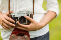 Mid section of woman holding vintage camera Royalty Free Stock Images