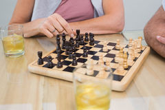Mid section of a woman and man playing chess Royalty Free Stock Images