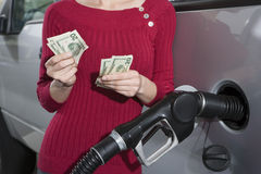Mid Section Of A Woman Refueling Her Car Stock Photo