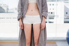 Mid section of woman in shorts and bathrobe Royalty Free Stock Photography