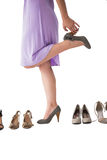Mid section of woman trying heels Stock Photography