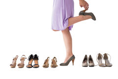 Mid section of woman trying heels Royalty Free Stock Images