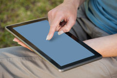 Mid section of a woman using digital tablet Stock Photo