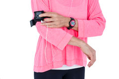 Mid section of woman using mp3 player in armband Royalty Free Stock Photos