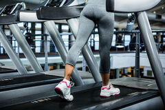 Mid section of woman using treadmill Royalty Free Stock Images