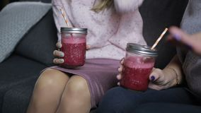 Mason jars of fresh smoothies in females hands stock footage