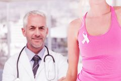 Composite image of mid section of woman wearing breast cancer awareness ribbon stock photography