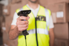 Mid section of worker holding scanner in warehouse Royalty Free Stock Images