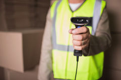 Mid section of worker with scanner in warehouse Stock Image
