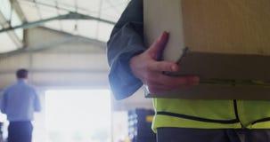 Worker walking with card board box in oil factory 4k stock video