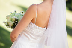 Mid section of a young beautiful bride with bouquet Royalty Free Stock Image