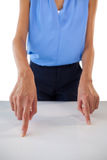 Mid section of young businesswoman gesturing on table Stock Photo