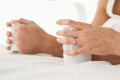 Mid section of young couple having coffee in bed Royalty Free Stock Photography