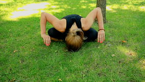 Mid shot Young woman doing yoga in park stock video footage