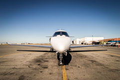Mid size jet parked Stock Images
