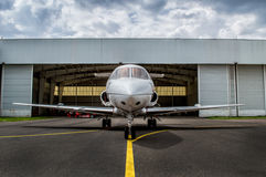 Mid size jet parked. Mid size jet parkinng in front of hangar and taxing Stock Images