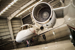 Mid Size jet Turbine. Mid Size jet parked in hangar Stock Images