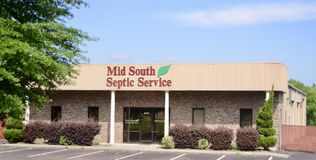 Mid South Septic Service, Arlington, TN. Mid South Septic offers a range of residential sewage system services. We specialize in septic tank pumping, field line Stock Photo