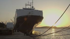Front view of docked ship at sunset, Conakry stock video