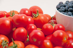 Mid-summer tomatoes and blueberries Stock Photos