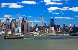 The Mid-town Manhattan Skyline on a sunny day Royalty Free Stock Photography