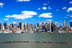The Mid-town Manhattan Skyline on a sunny day Stock Images