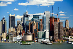 The Mid-town Manhattan Skyline on a sunny day Royalty Free Stock Photos